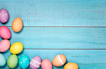 Colorful Easter Eggs arranged on a blue background.