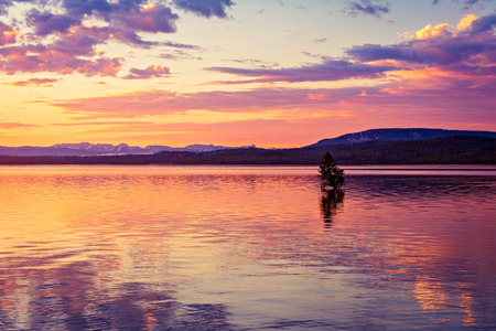 Sunrise on West Thumb Lake in Yellowstone National Park, Wyoming. Stock Photo