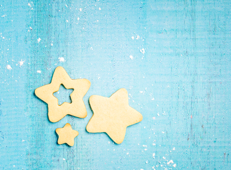 Star shaped Christmas cookies on a blue background.