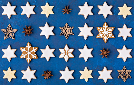 Various Star Cookies Christmas pattern on a blue background.