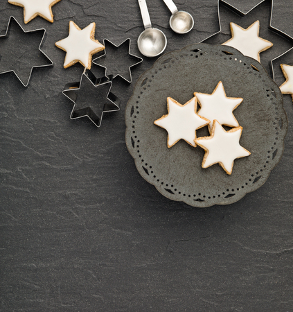Traditional German Star Cookies over a dark grey background.  Christmas or Yom Kippur.