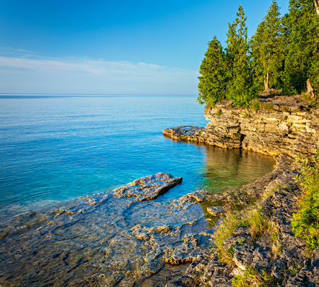 Early morning view of a small cove the coast of Lake Michigan from Cave Point Park in Door County Wisconsin.