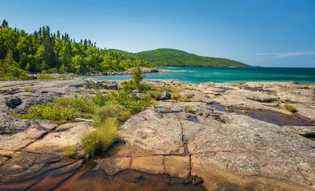 Scenic Landscape of the Volcanic Rock on the beautiful Rocky Coast of Lake Superior at at Neys Provincial Park, Ontario, Canada