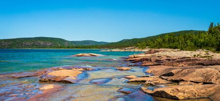 View of red stones on the coast of Lake Superior at Neys Provincial Park, Ontario, Canada