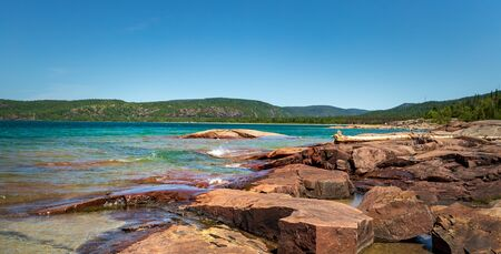 View of volcanic red stones on the coast of Lake Superior at Neys Provincial Park, Ontario, Canada