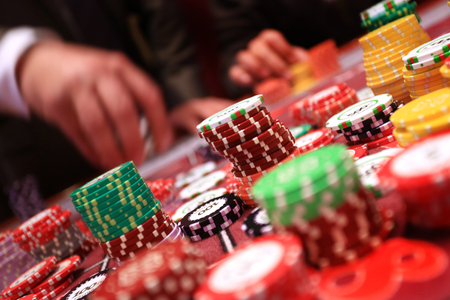 Player placing chips on a gambling table in casino. Stock Photo
