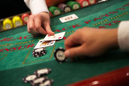 Dealer puts down a card on blackjack table
