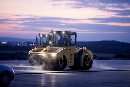 Road repair, vibration rollers at asphalt pavement works