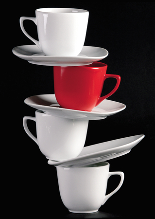 Stack of empty coffee cups on black background