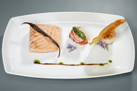meat with decoration on white plate. gourmet food Banque d'images - 100045901