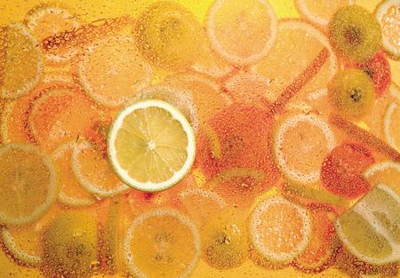 lemon slice on fruit mix background, citrus yellow