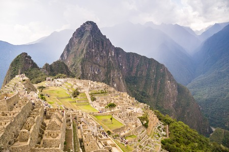 infamous: Machu Picchu: Dark clouds announce the comming rain at Perus infamous Inca city Stock Photo