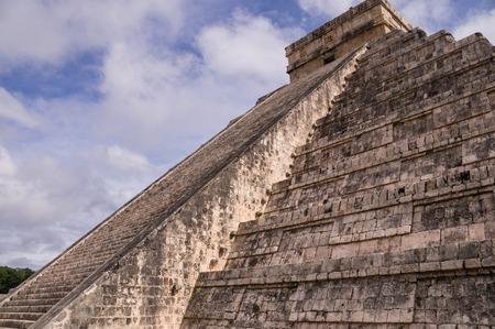 attracts: Chichen Itza: The infamous Maya pyramid in Yucatan, Mexico attracts millions of visitors