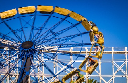 At an amusement park a Giant Wheel is moving rapidly