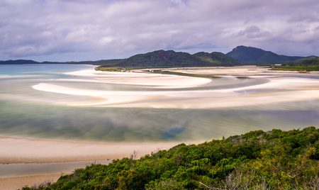 whitehaven beach: View from hill inlet lookout on Whitehaven beach at Whitsunday Island near Airlie Beach, Australia at low tide. The beautiful green color is very rare. Stock Photo