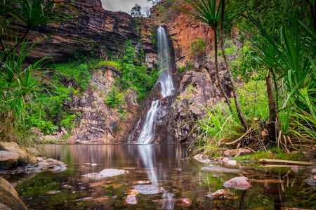 The Tjaynera Falls at Sandy Creek are among the least visited sights of Litchfield National Park in Australias Northern Territory. The falls can only be reached by a 4x4 track and a walk. Stock Photo
