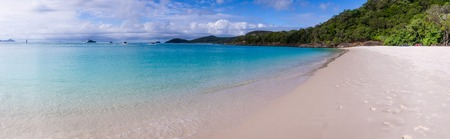 whitehaven beach: Panorama of Whitehaven beach at Whitsunday Island in Queensland, Australia. Whitehaven beach is a well known landmark known for its beautiful white sand and clear wates. Stock Photo