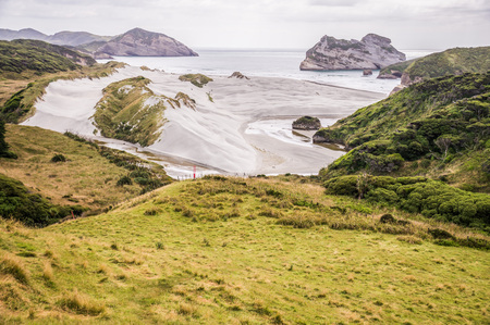 View on Wharariki beach, South Island, New Zealand from grassy sanddune overlooking the beach