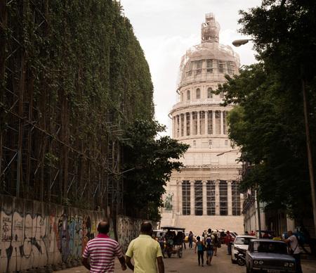 capitolio: Havana, Cuba on December 23, 2015: Cuban people walking towards capitolio goverment building