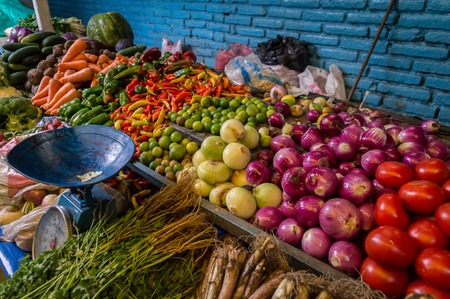 red onions: Fresh vegetables with old scale sold on Otavalo market, Ecuador
