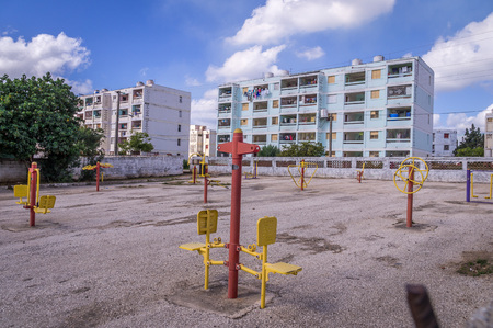 The real Cuba: Emty playground and apartment blocks in residential area in Trinidad, Cuba Stock Photo