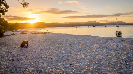 airlie: Sunset view of Whitehaven beach at Whitsunday Island in Queensland, Australia. Whitehaven beach is a well known landmark known for its beautiful white sand and clear turquoise wates