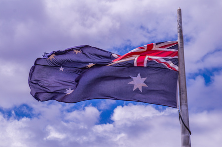 Fluttering Australian Flag with blue sky background in wind