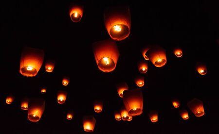 Glowing paper lanterns illuminate the night sky during the Pingxi sky lantern festival in Taiwan
