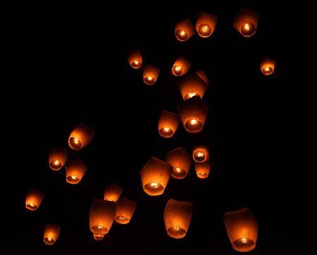 Glowing paper lanterns illuminate the night sky during the Pingxi sky lantern festival in Taiwan