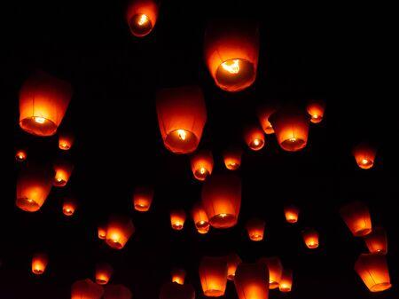 Glowing paper lanterns illuminate the night sky during the Pingxi sky lantern festival in Taiwan Archivio Fotografico