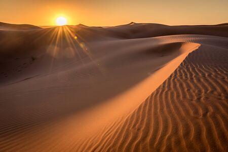 Golden hour Sunrise over the Sahara Dunes, Merzouga, Morocco Stock Photo
