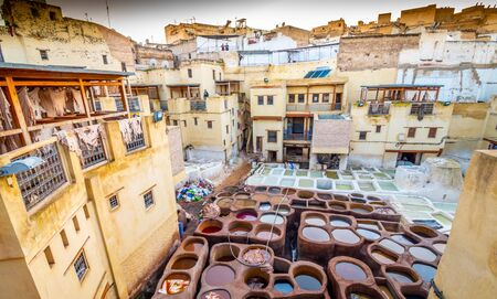 Overlooking stone vessels with colorful dyes in tanneries, Fez, Morocco
