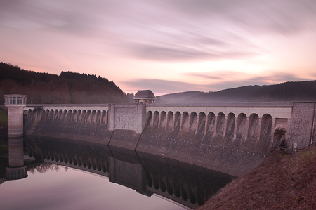 hydropower: A beautiful colorful sunset at the reservoir dam of the lister