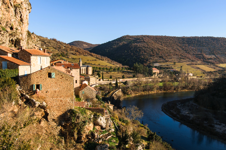 millau: Beautiful view over the village Peyre in France next to the river Tarn at beautiful weather with sunshine and blue sky Stock Photo