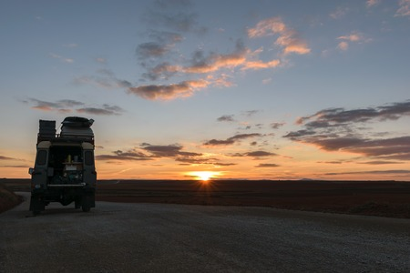 A fully equipped off-road vehicle oldtimer at a beutiful sunset in Spain