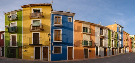 Panorama of mutlicolored houses in the streets of Villajoyosa with blue sky and sunny weather at the Costa Blanca in Spain