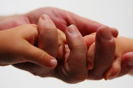 Father holding hand of newborn on white background Stock Photo - 5991284