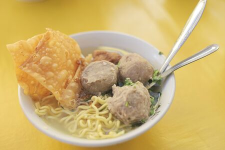 Delicious BaksoMeatball served wirth noodle, vegetables, stock soup, and fried dumpling.