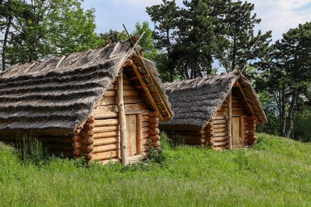 Historic Slavic dwelling on the Molpir hill in the Little Carpathians. Two wooden cottages with straw roof on the hillfort.