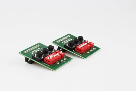 Set of two electronic components isolated on white background. PCB assembly Фото со стока