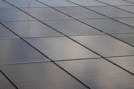 Solar panels at the top of the building. Solar modules on a flat roof.