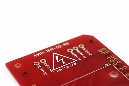 Multiplied printed circuit boards PCB isolated on the white background. PCB assembly. High voltage warning and sign