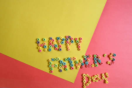 """""""happy father's day"""" poster made with colored cereals on orange and yellow background Imagens"""