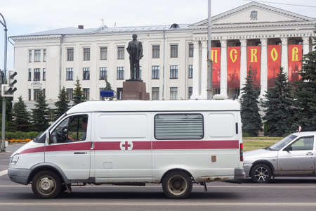 Pskov Russia 06.07.2020 Ambulance on the background of the monument to Lenin and Pskov state University