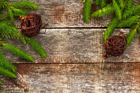 Christmas background for greeting card. Fir branches on wooden background. Stock Photo