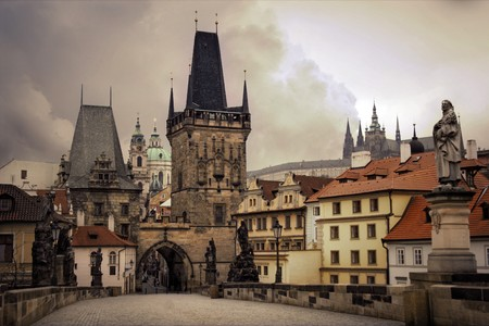 Charles Bridge is a bridge that crosses the Vltava river in Prague