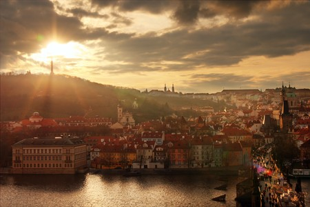 Panoramic view of Prague Castle and Charles Bridge through Vltava river. photo
