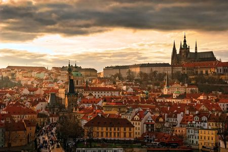 castle district: Panoramic view of Prague Castle and Charles Bridge through Vltava river. Stock Photo