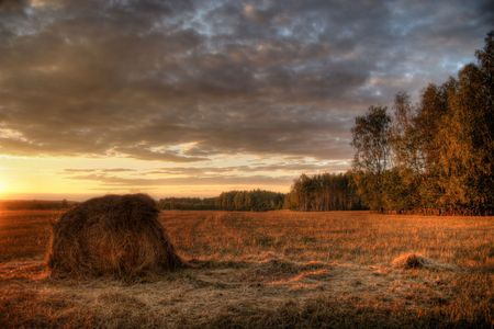 Landscape with  field, haystack and sunset Stock Photo - 5051045