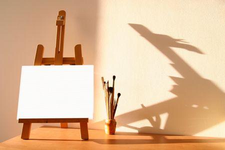 テーブル イーゼル キャンバス、水彩ブラシ 写真素材